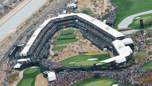 SCOTTSDALE, AZ - JANUARY 31:  A large group of fans watch the play around the par-three 16th hole during the third round of the Waste Management Phoenix Open at TPC Scottsdale on January 31, 2015 in Scottsdale, Arizona.  (Photo by Scott Halleran/Getty Images)