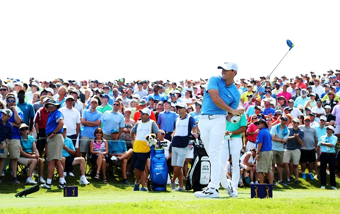 McIlroy flirts with course record