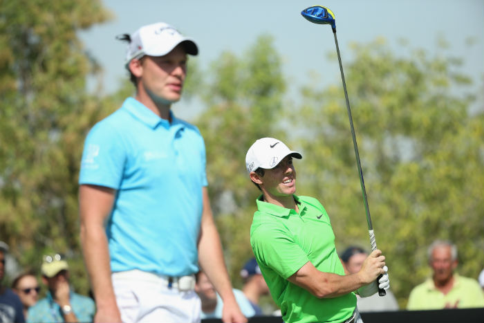 McIlroy delights fans, Willett leads