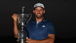 OAKMONT, PA - JUNE 19:  Dustin Johnson of the United States poses with the winner's trophy after winning the U.S. Open at Oakmont Country Club on June 19, 2016 in Oakmont, Pennsylvania.  (Photo by Ross Kinnaird/Getty Images)