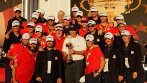 CHASKA, MN - OCTOBER 02: Captain Davis Love III of the United States celebrates with his team and their caddies during the closing ceremony of the 2016 Ryder Cup at Hazeltine National Golf Club on October 2, 2016 in Chaska, Minnesota.  (Photo by Jamie Squire/Getty Images)