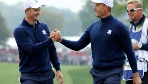 CHASKA, MN - SEPTEMBER 30: Henrik Stenson and Justin Rose of Europe react on the ninth green during morning foursome matches of the 2016 Ryder Cup at Hazeltine National Golf Club on September 30, 2016 in Chaska, Minnesota.  (Photo by David Cannon/Getty Images)