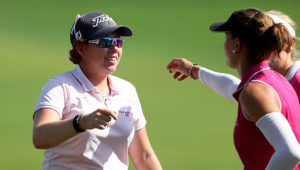 DUBAI, UNITED ARAB EMIRATES - DECEMBER 09:  Felicity Johnson of England is congratulated by her playing partners on the 18th green after her 8 under par round of 64 during the delayed second round of the 2016 Omega Dubai Ladies Masters on the Majlis Course at the Emirates Golf Club on December 9, 2016 in Dubai, United Arab Emirates.  (Photo by David Cannon/Getty Images)