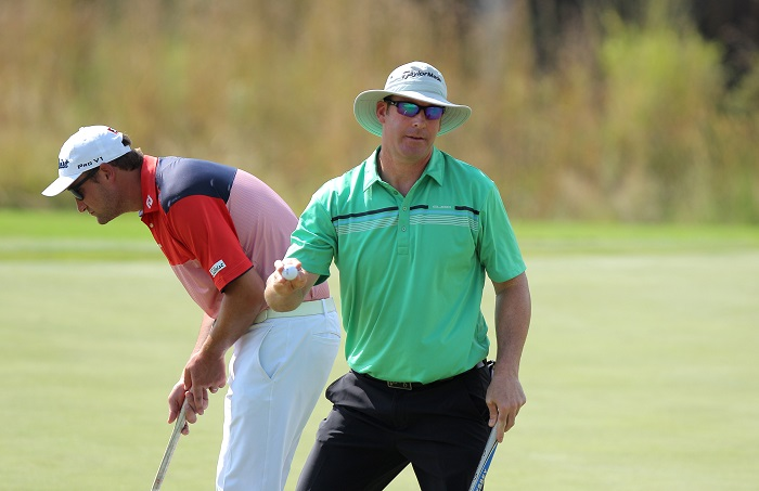 Hicks sinks huge birdie for PGA Champs lead