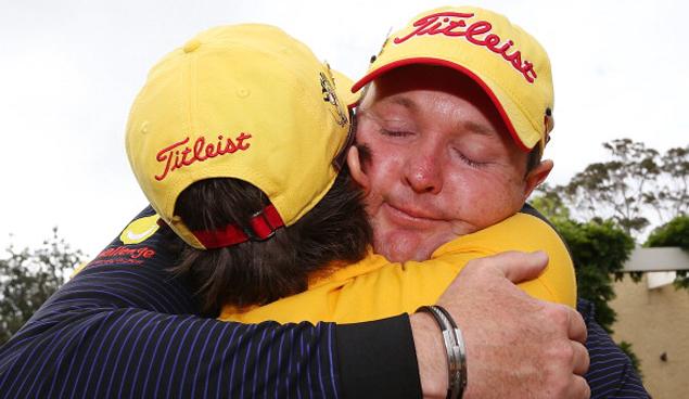 Jarrod Lyle of Australia hugs wife Briony Lyle