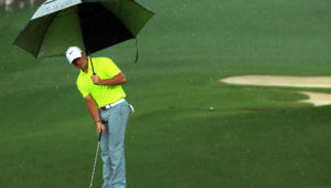Rory McIlroy playing in the rain