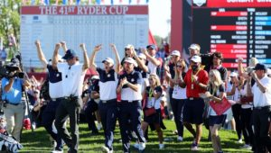 United States celebrate on the 18th green at Ryder Cup