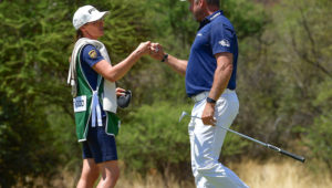 Helen Storey caddies for Lee Westwood