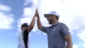 Xander Schauffele holes out
