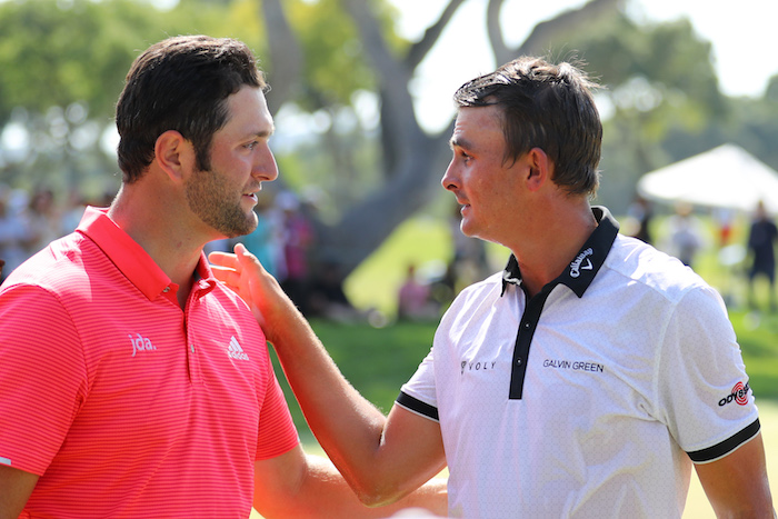 Christian Bezuidenhout of South Africa is congratulated on his victory on the 18th green by Jon Rahm of Spain